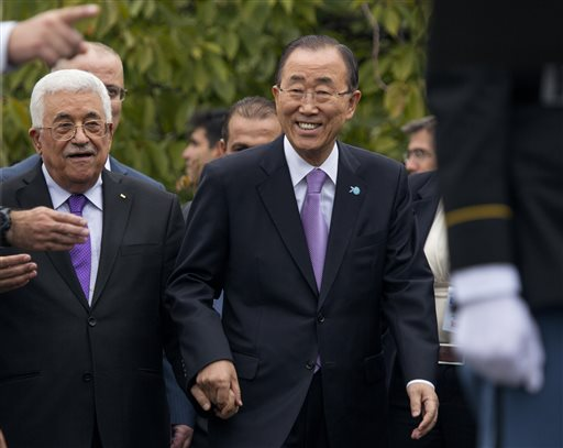 Palestinian president Mahmoud Abbas, left,   walks with United Nations Secretary-General Ban Ki-moon during a ceremony to raise the State of Palestine flag for the first time on Wednesday, Sept. 30, 2015, at the U.N. (AP Photo/Craig Ruttle)