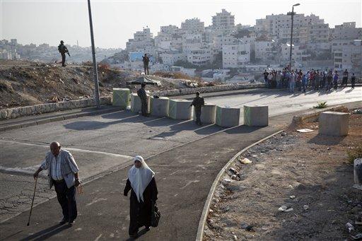 Israel Erects Barrier In East Jerusalem Area