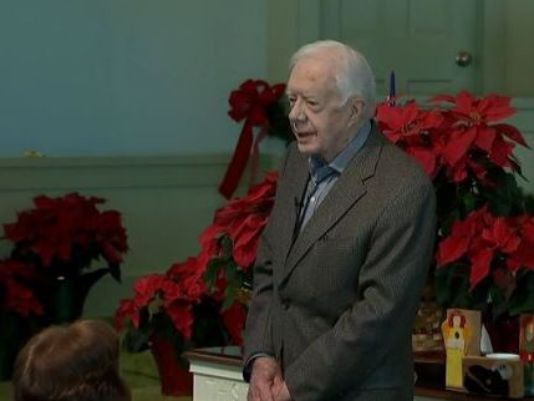 Former US President Jimmy Carter stands before a full sanctuary at Maranatha Baptist Church in Plains, Ga. to deliver tragic news ahead of his Sunday school class. (Photo: WXIA-TV, Atlanta)