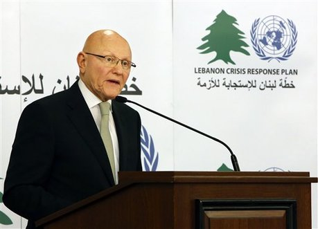 Lebanese Prime Minister Tammam Salam, speaks during a ceremony announcing the launch of the Lebanon Crisis Response Plan in Beirut, Lebanon, Monday, Dec. 15, 2014. The plan announced Monday call for an estimated $2.1 billion to help Lebanon cope with the fallout from the conflict in neighboring Syria. (AP Photo/Bilal Hussein)