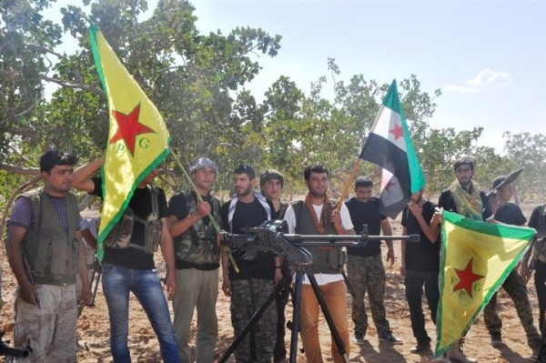 Fighters from the Syrian Democratic Forces (SDF) coalition, which includes Kurds, Arabs and Syriac Christians (AFP)