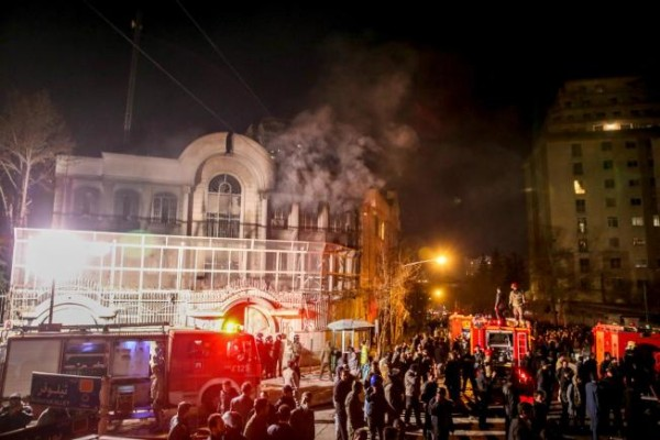 The Associated Press Smoke rises as Iranian protesters set fire to the Saudi embassy in Tehran, Sunday, Jan. 3, 2016. Protesters upset over the execution of a Shiite cleric in Saudi Arabia set fires to the Saudi embassy in Tehran. (Mohammadreza Nadimi/ISNA via AP)
