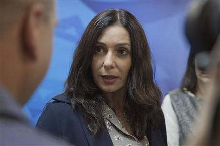 In this Sunday, June 21, 2015 file photo, Israeli Minister of Culture and Sport Miri Regev speaks during the weekly cabinet meeting in Jerusalem. Regev caused an uproar this week in parliament by vowing to press ahead with legislation that would allow her as minister to determine what cultural institutions and projects could be denied funding based on a list of criteria that could include denigrating the national flag or state symbols, denying Israel's existence as a Jewish and democratic state, or promoting Israel's independence day as a day of mourning.(AP Photo/Dan Balilty, File)