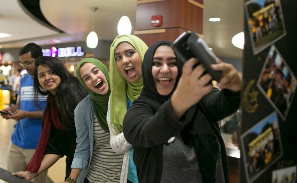Maira takes a selfie with members of the Muslim Students Association at Wichita State University.