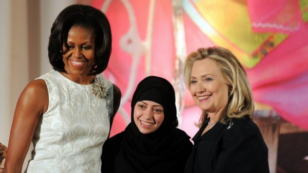 Political activist Samar Badawi is presented with an International Women of Courage Award by US Secretary of State Hillary Clinton and first lady Michelle Obama in Washington on March 8, 2012. Alex Wong, Getty images, AFP |