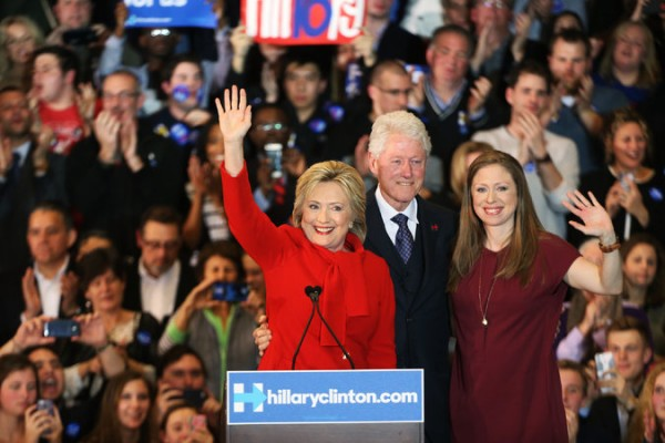Hillary Clinton with former President Bill Clinton and their daughter, Chelsea, at her caucus night rally in Des Moines on Monday.  NY TIMES