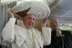 ope Francis wears a traditional Mexican sombrero hat he received as a gift by a Mexican journalist aboard the plane during the flight from Rome to Habana, Cuba, on his way to a week-long trip to Mexico, Friday, Feb. 12, 2016. The pontiff is scheduled to stop in Cuba for an historical meeting with Russian Orthodox Patriarch Kirill that the Vatican sees as a historic step in the path toward healing the 1,000-year schism that split Christianity. At right is Vatican spokesperson Rev. Federico Lombardi. (Alessandro Di Meo/Pool Photo via AP)