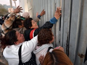 Relatives of prisoners demand information about the fire and riot, outside the prison of Topo Chico, in Monterrey, Nuevo Leon, Mexico, on Feb. 11, 2016. February 2016. Scores of people died in a prison fire and riot. (Photo: Miguel Sierra, European Pressphoto Agency)