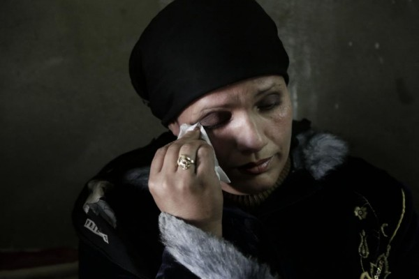 In this Thursday, March 3, 2016 photo, Fadya Shehata Moussa, the mother mother of 17-year-old Bassem Amgad Hanna, one of four teens convicted for contempt of Islam, wipes away tears during an interview in Bani Mazar, Minya province, Egypt. The four teens and their supervisor, who was forced to leave the village with his family, were all convicted. Though all the defendants are under 18, three were sentenced to adult prison for five years and one to a juvenile detention facility for three years. The supervisor received a three year prison sentence. (AP Photo/Thomas Hartwell)