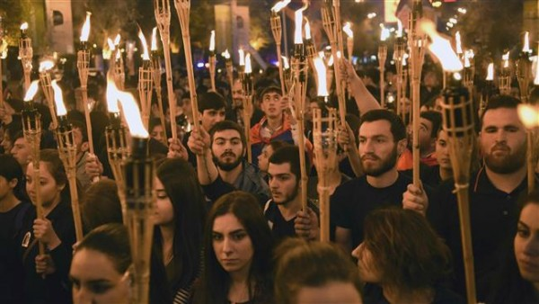 Armenians carry torches during a march in commemoration of the 101th anniversary of Armenian Genocide by Ottoman forces in 1915. (AFP)