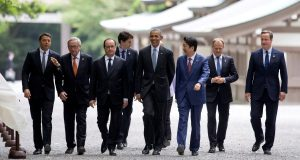 From left, Italian Premier Matteo Renzi, European Commission President Jean-Claude Juncker, French President Francois Hollande, Canadian Prime Minister Justin Trudeau, German Chancellor Angela Merkel U.S. President Barack Obama, Japanese Prime Minister Shinzo Abe, European Council President Donald Tusk, and British Prime Minister David Cameron, walk past the Kaguraden as they visit Ise Jingu shrine in Ise, Mie Prefecture, Japan, Thursday, May 26, 2016, as part of the G-7 Summit. REUTERS/Carolyn Kaster/Pool      TPX IMAGES OF THE DAY