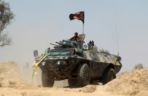 Iraq government forces supported by US airstrikes  retook a town from ISIL