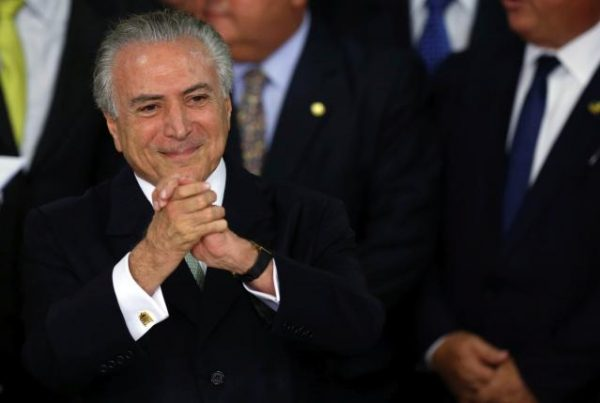 Brazil's interim President Michel Temer gestures during a ceremony where he made his first public remarks after the Brazilian Senate voted to impeach President Dilma Rousseff at the Planalto Palace in Brasilia, Brazil, May 12, 2016. REUTERS/Adriano Machado