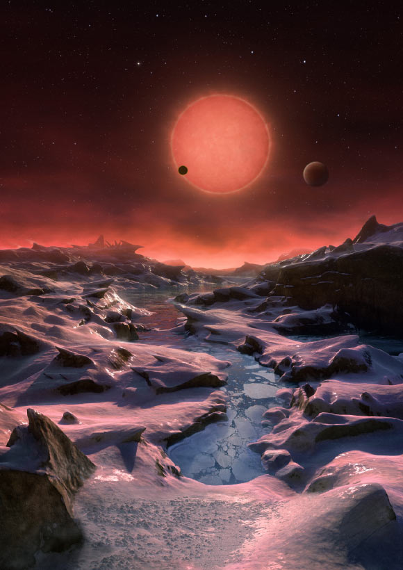This artist's impression shows an imagined view from the surface one of the three exoplanets orbiting the ultracool dwarf star TRAPPIST-1 38.8 light-years from Earth. These alien worlds have sizes and temperatures similar to those of Venus and Earth. In this view one of the inner planets is seen in transit across the disc of TRAPPIST-1. Image credit: M. Kornmesser / ESO. This artist's impression shows an imagined view from the surface one of the three exoplanets orbiting the ultracool dwarf star TRAPPIST-1 38.8 light-years from Earth. These alien worlds have sizes and temperatures similar to those of Venus and Earth. In this view one of the inner planets is seen in transit across the disc of TRAPPIST-1. Image credit: M. Kornmesser / ESO.