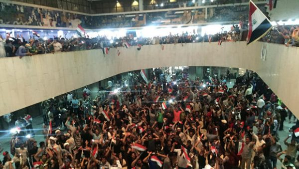 After months of tensions, the political crisis in Iraq escalated with anti-government protesters storming into parliament. This is why they are protesting. (Claritza Jimenez/The Washington Post)