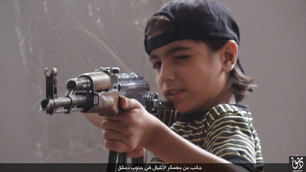 ISIS child soldier shown south of Damascus. Most rival factions in Syria use child soldiers