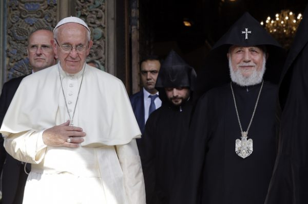 Pope Francis and Catholicos Karekin II leave the Apostolic Cathedral of Etchmiadzin, in Yerevan, Armenia, Friday, June 24, 2016. Pope Francis is in Armenia for a three-day visit. (AP Photo/Andrew Medichini)