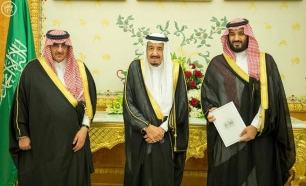 (L-R) Saudi Crown Prince Mohammed bin Nayef, Saudi King Salman, and Saudi Arabia's Deputy Crown Prince Mohammed bin Salman stand together as Saudi Arabia's cabinet agrees to implement a broad reform plan known as Vision 2030 in Riyadh, April 25, 2016. Saudi Press Agency/Handout/File Photo via REUTERS.