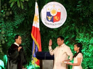 President Rodrigo Duterte takes his oath before Supreme Court Justice Bienvenido Reyes as his daughter Veronica holds the bible, during his inauguration as President of the Philippines at the Malacanang Palace in Manila, Philippines June 30, 2016. Presidential Palace/Handout via Reuters