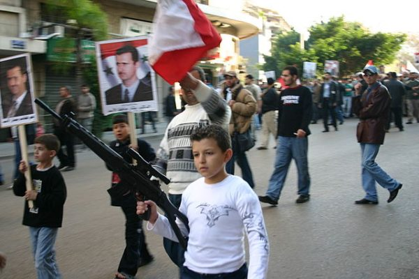 SSNP  supports  demonstrate in favor of the Syrian regime. An SSNP  child soldier was reportedly killed recently in Syria  while fighting to defend Bashar al Assad's regime