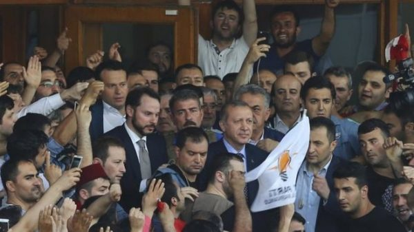 President Erdogan (centre) told his cheering supporters that the army must be cleansed