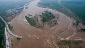 An aerial view shows flooded roads and fields in Xingtai, Hebei province, China, July 21, 2016. REUTERS/STRINGER