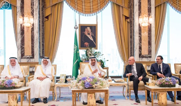 In this photo courtesy of Dalati and Nohra , King Salman of Saudi Arabia ( C) is shown with Lebanese PM Tammam Salam (2d R  ) and Former PM Saad Hariri (R)