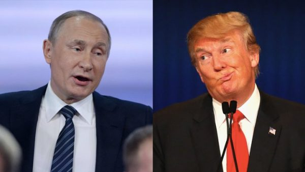 Russian President Vladimir Putin (L) praised   Donald Trump  (R) during his annual press conference in Moscow, on December 17, 2015.  singled him out as an absolute leader.  (AFP Photo/Natalia Kolesnikova)