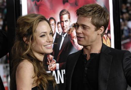 """Angelina Jolie and Brad Pitt arrive at the premiere of """"Ocean's Thirteen"""" held at Grauman's Chinese Theatre in Los Angeles, Calif., Tuesday, June 5, 2007. (AP Photo/Chris Pizzello)"""