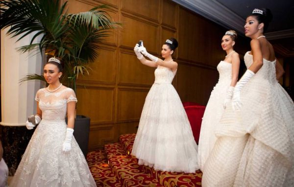 02/11/2013 JOUNIEH, LEBANON Taline Mansour, (center) poses for a self portait on her mobile phone, while amongst Debutante Ball participants, before the Ball at Casino du Liban where the Ball is held.