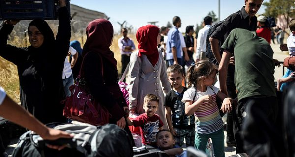 Syrian refugees on their way back to the Syrian city of Jarablus on Sept. 7