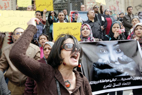 Egyptian lawmaker's call for virginity tests draws fire. an Egyptian activist shouts anti-military Supreme Council slogans during a demonstration in front of Cairo's high court. — AP