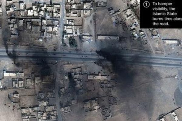 Smoke is seen in this satellite image of the city of Mosul in Iraq on October 18, 2016. Courtesy of Stratfor.com/AllSource Analysis/DigitalGlobe/Handout via REUTERS