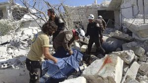 In this photo provided by the Syrian Civil Defense group known as the White Helmets, Syrian Civil Defense workers search through the rubble after airstrikes in the village of Hass in the Idlib province, Syria, on Oct. 26, 2016. Syrian activists say that airstrikes outside a school in the northern, rebel-held province of Idlib have killed 17 people, mostly children. The Idlib News network says the airstrikes hit as the children gathered outside a school complex in the village of Hass. (Syrian Civil Defense White Helmets / AP)