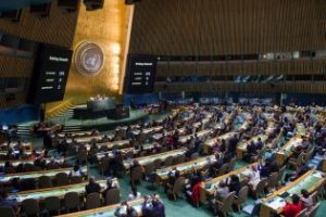 The U.N. General Assembly votes on Wednesday, October 26, 2016 in favor of a resolution condemning the U.S. embargo on Cuba. The large screens provide the vote outcome - 191-0, with two abstentions. (UN Photo/Amanda Voisard)