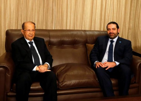 FPM founder Michel Aoun (L) sits next to Lebanon's former prime minister Saad al-Hariri after he said he will back Aoun to become president in Beirut, Lebanon October 20, 2016. REUTERS/Mohamed Azakir