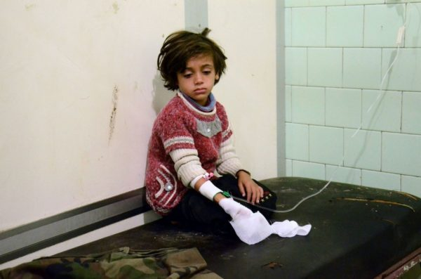 An injured child waits after receiving treatment at the university hospital in a government-held neighborhood on Nov. 3, following reported rebel fire on government-held parts of the northern city of Aleppo. (GEORGE OURFALIAN/Agence France-Presse via Getty Images)