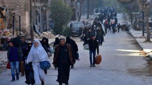Several people left Bab al-Hadid, a district of Aleppo that rebels have reportedly lost, on Wednesday