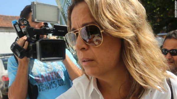 Francoise De Souza Oliveira arrives at a police station on Friday to be questioned.