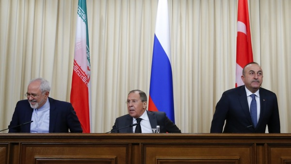 Foreign ministers, Sergei Lavrov (C) of Russia, Mevlut Cavusoglu (R) of Turkey and Mohammad Javad Zarif of Iran, prepare for a news conference in Moscow, December 20th 2016. The 3 will reportedly decide the fate of Syria