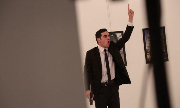 The gunman gestures after shooting Karlov. Photograph: Burhan Ozbilici/AP