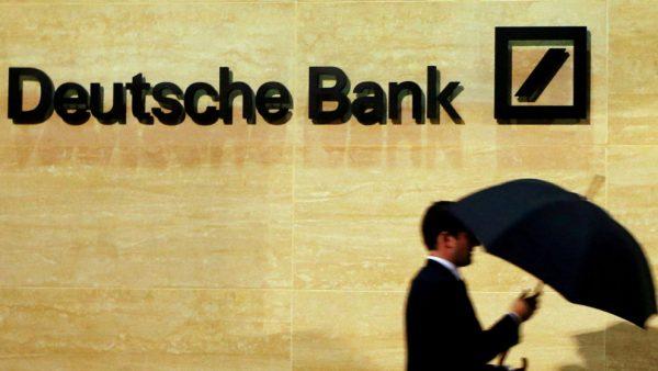 A man walks past Deutsche Bank offices in London, Britain, December 5, 2013. REUTERS/Luke MacGregor/File Photo - RTSQ0LR