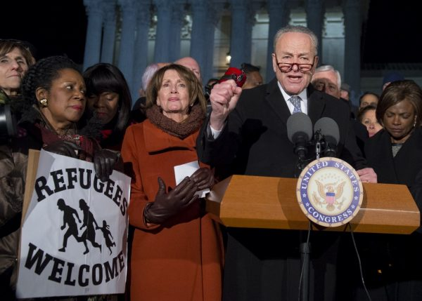 Senate Minority Leader Chuck Schumer (D-N.Y) speaks alongside House Minority Leader Nancy Pelosi (D-Calif.) and other members of Congress as demonstrators protest against President Trump and his administration's ban of refugees from around the world and foreign nationals from seven Muslim-majority countries. (Saul Loeb/AFP/Getty Images)