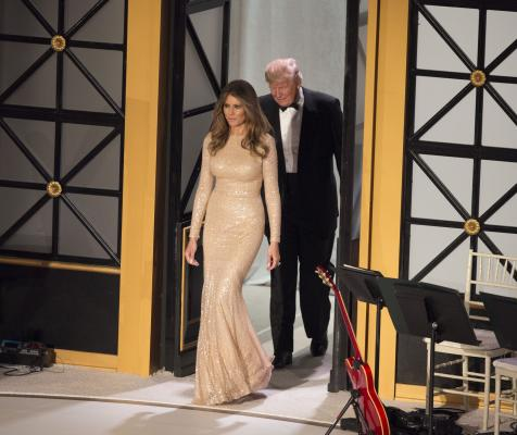 President-elect of The United States Donald J. Trump and Melania Trump who wore a sparkly Reem Acra gold gown arrive at a candlelight dinner to thank donors in Washington, DC, January 19, 2017. The inauguration is January 20. Pool Photo by Chris Kleponis/UPI | License Photo