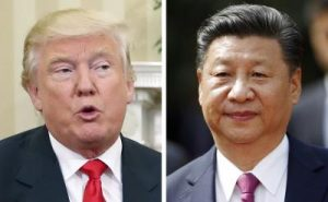 US presdient  Donald Trump (L)  and  Chinese President Xi Jinping . Xi Jinping  warned Donald Trump   when he was president elect  against isolationist moves which could spark a trade war.