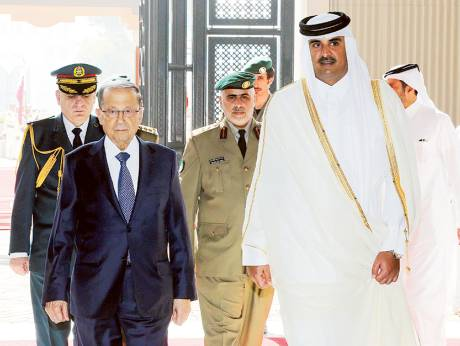 A handout picture provided by the Lebanese photo agency Dalati and Nohra on Wednesday shows Emir of Qatar Shaikh Tamim Bin Hamad Al Thani welcoming Lebanese President Michel Aoun upon his arrival in Doha.