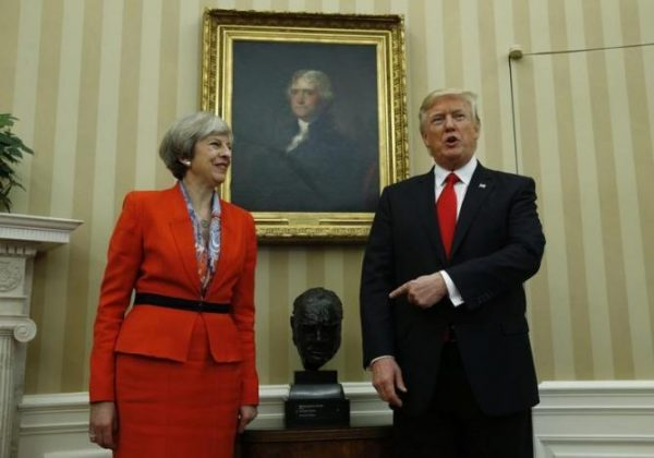 U.S. President Donald Trump points to British Prime Minister Theresa May in the White House Oval Office in Washington, U.S., January 27, 2017. REUTERS/Kevin Lamarque