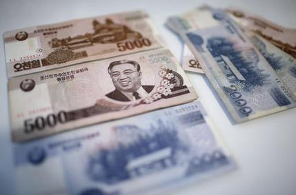 A portrait of the late Kim Il Sung is seen on the 5,000 bill of the North Korean won, Monday, Feb. 6, 2017. While foreign brand-name goods are often paid for in the U.S. dollars, Euros or Chinese yuan, and priced accordingly at the official exchange rate, most people buy their daily necessities in North Korea's own currency, the won, which has an unofficial and more market-friendly exchange rate. (AP Photo/Wong Maye-E)