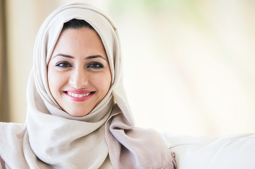 A middle eastern woman wearing a headscarf