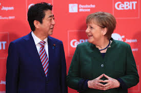 Germany's Merkel, Japan's Abe
